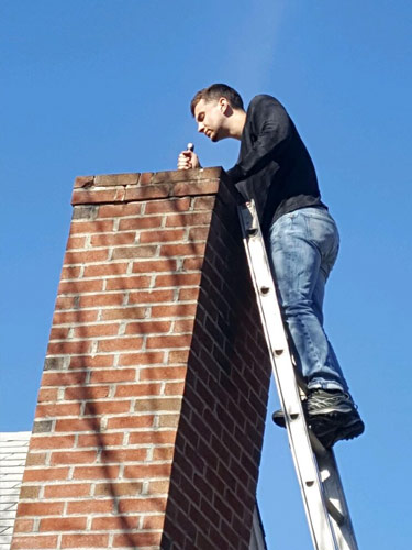 spartan-worker-checking-chimney-for-pests