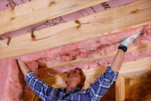 spartan-worker-installing-insulation